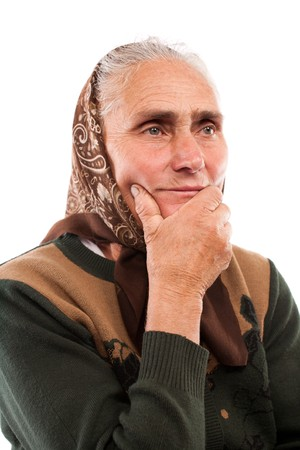 Close up portrait of an old woman isolated on white background photo