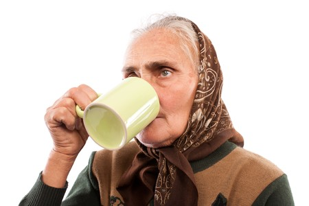 Closeup portrait of an old woman drinking from a cup Stock Photo - 7891056