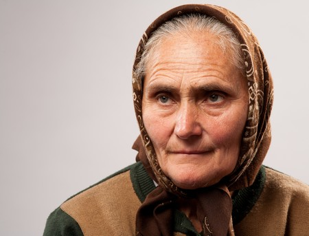 head scarf: Close up portrait of an old woman isolated on white background Stock Photo