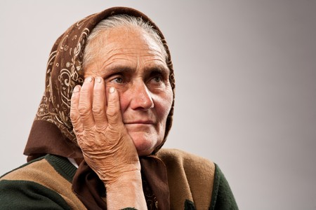Close up portrait of a sad older woman