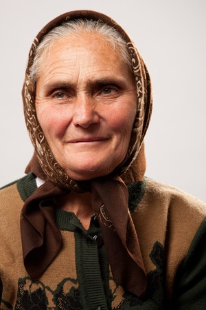 Portrait of a happy old woman isolated on white Stock Photo