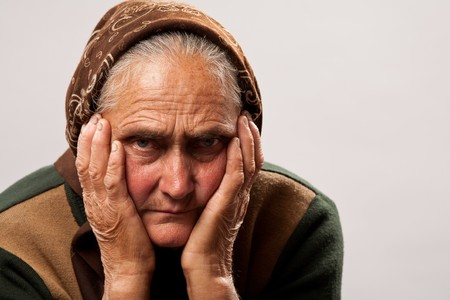 peasant: Close up portrait of a sad older woman