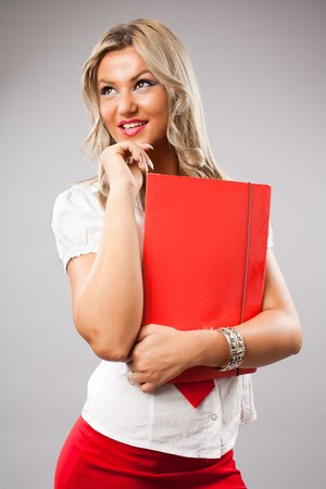 Portrait of a beautiful young business woman, studio shot photo