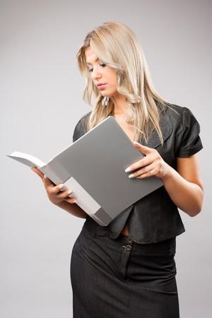 Portrait of a beautiful young business woman, studio shot photo