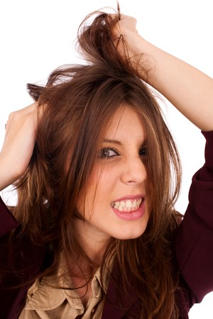 Portrait of a desperate young businesswoman pulling her hair Stock Photo - 7914085