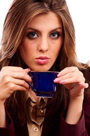 Portrait of a beautiful businesswoman enjoying her coffee photo