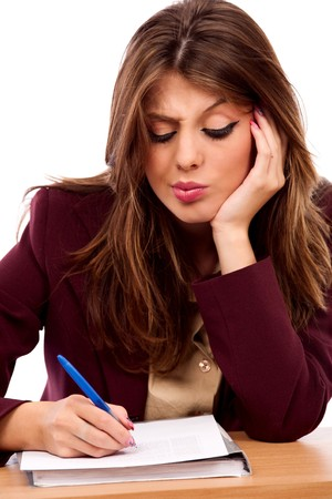 Close up portrait of an attractive businesswoman writing a contract photo