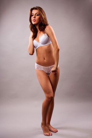 Full body shot of a beautiful woman in white lingerie photo
