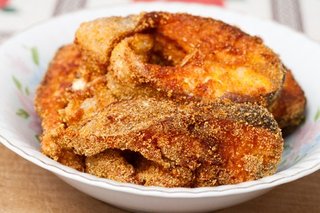 Delicious salmon fillets roasted in the frying pan photo