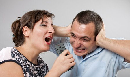 Domestic fight between husband and wife, studio shot photo