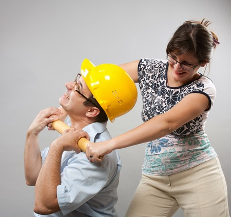 Domestic fight between husband and wife, studio shot photo