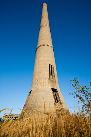 Huge industrial tower against the blue sky at sunset photo