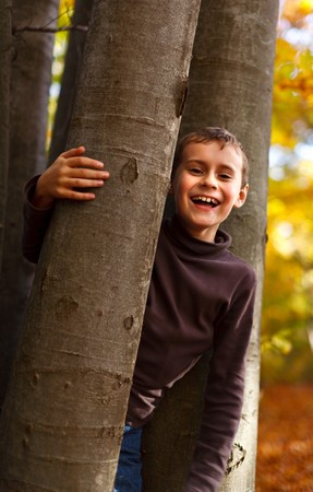 Cute kid playing outdoor in a beautiful autumn day Stock Photo - 8147496
