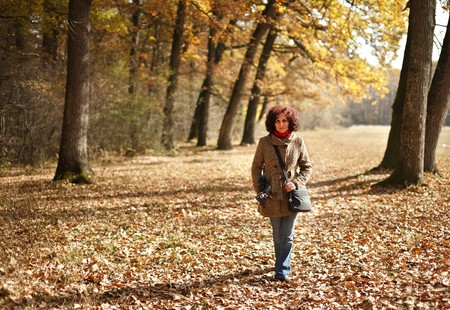 Portrait of a young woman outdoor in the forest Stock Photo - 8147646