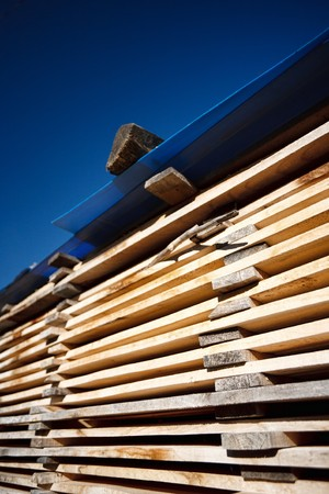 Stacks of planks against the deep blue sky Stock Photo - 8147662