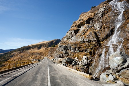 Landscape with Transfagarasan, a famous road in Romania, crossing the mountains, near a small waterfall photo