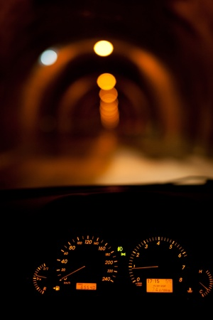 Car dials with a blurred tunnel with lights seen in background Stock Photo - 8225741