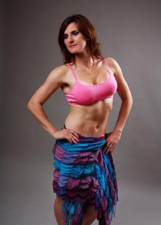 Young athletic woman doing aerobics or yoga photo