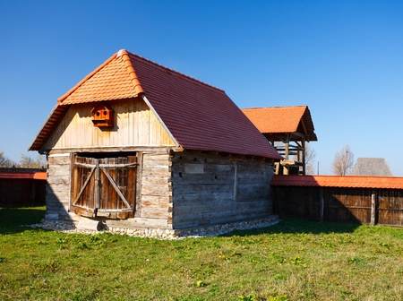 Old traditional Romanian barn or shack under blue sky - this is part of a series of images with countryside buildings in Romania Stock Photo - 8336179