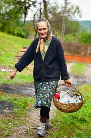 Full body portrait of a rural woman with basket outdoor photo