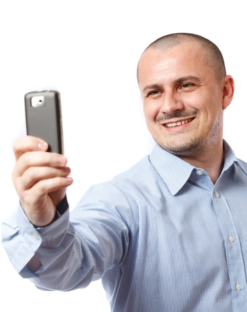 photographing: Young businessman taking photos with his cellphone Stock Photo