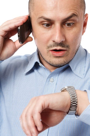 Young businessman worried looking at his wrist watch photo