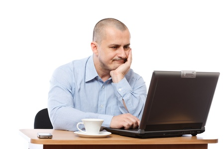 Tired and stressed young businessman working at his computer Stock Photo - 8395927