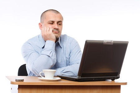 Tired and stressed young businessman working at his computer Stock Photo - 8395925