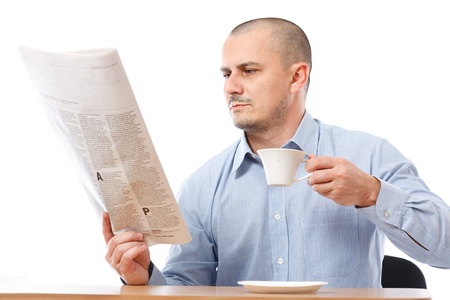 Young businessman reading newspaper isolated on white background Stock Photo - 8395933