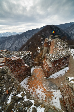Landscape with Draculas fortress at Poienari, Romania photo