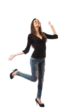Full length shot of a beautiful hispanic woman in high heels and jeans, isolated on white background photo