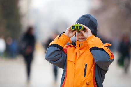Little boy using binoculars outdoor in an urban environment Stock Photo - 8631712