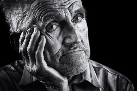 poor people: Monochrome stylized portrait of an expressive old man Stock Photo
