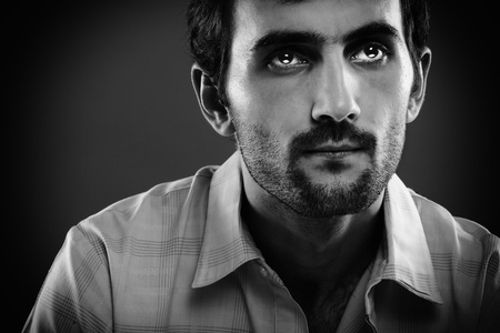 Monochrome toned portrait of a serious young man photo