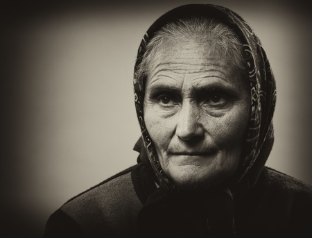farmer's: Close up portrait of an old woman isolated on white background Stock Photo