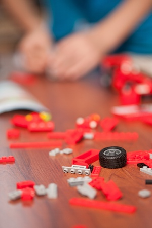 preoccupied: Kid playing with toys indoor, in his room Stock Photo