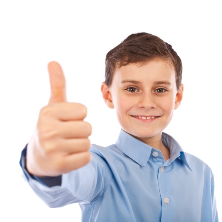 good shirt: Cute schoolboy making thumbs up sign, isolated on white background Stock Photo
