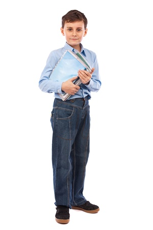Full length portrait of a schoolboy holding several books and notebooks photo