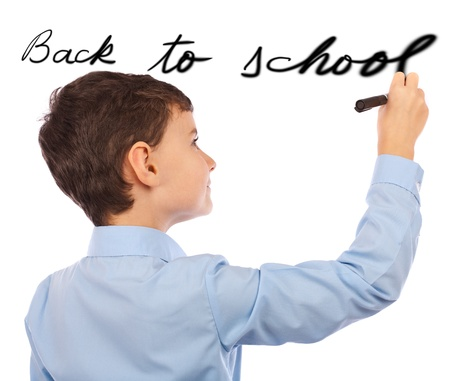 writing activity: Schoolboy writing back to school on an imaginary board