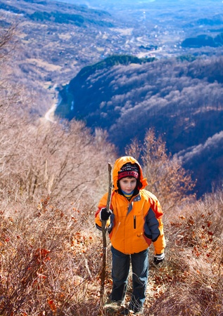 Little boy hiking in the mountains, in a sunny day Stock Photo - 8878405