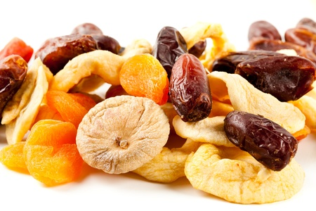 Closeup of dried fruits mix isolated on white background photo