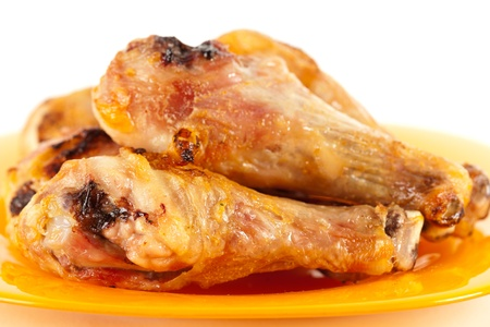 Closeup of grilled chicken drumsticks isolated on white background Stock Photo - 8878157