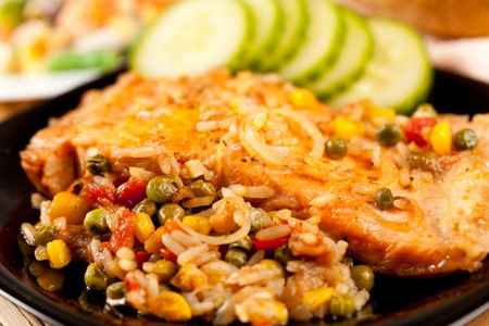 Closeup of salmon fillets served with vegetables garnish Stock Photo - 8888478