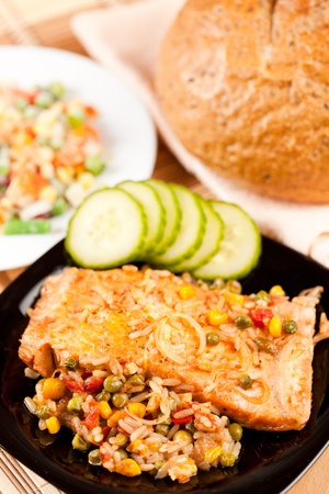 Closeup of salmon fillets served with vegetables garnish Stock Photo - 8888465