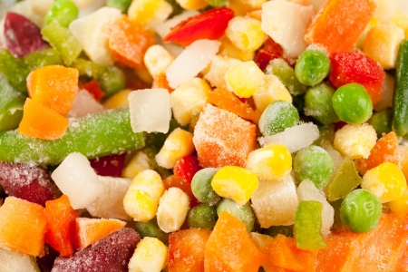 Close up of a mix of frozen vegetables ready to be cooked photo