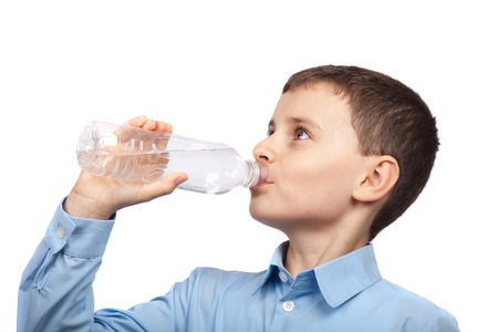 Closeup portrait of a boy drinking water, isolated on white background