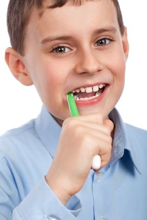 Closeup portrait of a  boy brushing his teeth photo