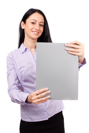 Attractive hispanic businesswoman holding a folder with copyspace, isolated on white background Stock Photo - 8980217