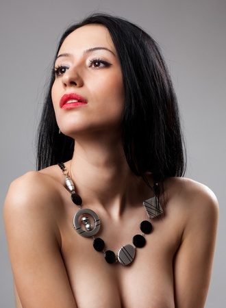 Closeup portrait of a gorgeous hispanic young woman, studio shot