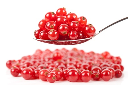 Macro of fresh red currant berries isolated on white background photo